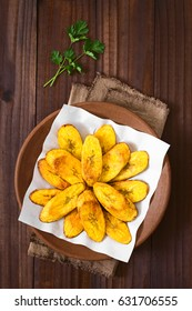 Fried slices of ripe plantains, a traditional and popular snack and accompaniment in Central America and Northern South America, photographed overhead on dark wood with natural light
