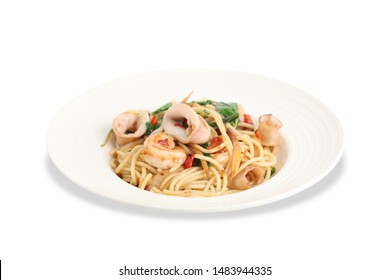 Fried spaghetti drunken noodles with seafoods isolated on white background,Clipping path.