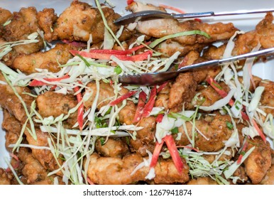 A fried spicy Chiken with vegetable salad