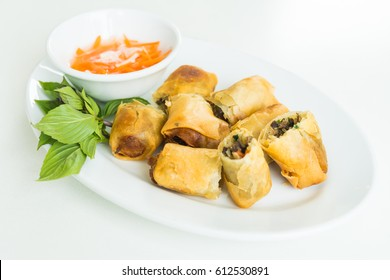 Fried spring roll in white plate