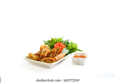 fried spring rolls in white bowl with Sweet sauce / Selective focus image