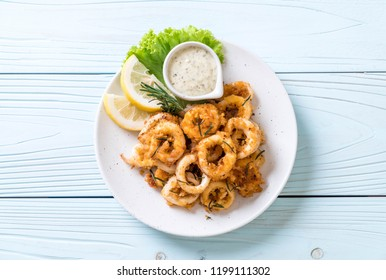 fried squids or octopus (calamari) with sauce - unhealthy foods
