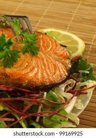 Fried steak of salmon with lettuce