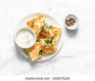 Fried stuffed chickpeas, spinach, leek and mozzarella rolls on a light background, top view. Delicious snack, appetizers, tapas or breakfast