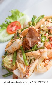 fried Sukiyaki with seafood and vegetables, Thai style with sauce on white dish