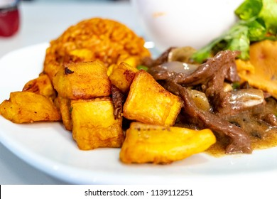 Fried Sweet Plantains. Ripe fried plantain - local banana served for jollof rice and meat sauce in Nigeria, Ghana or Guatemala also called plantano