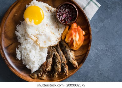 fried tawilis with egg and rice; most common household food in the Philippines