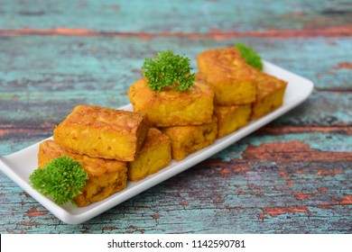 Fried tempeh. Made by a natural culturing and controlled fermentation process that binds soybeans into a cake form. Soybean product originating from Indonesia