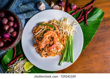 Fried Thai Noodle with Pad Thai and Vegetable, Put on Wooden Table