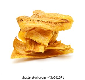 Fried thinly sliced banana chips, a tropical snack on white