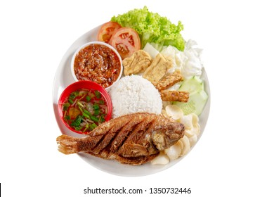 Fried tilapia fish and rice, popular traditional Malay or Indonesian local food. Isolated on white background. Flat lay top down overhead view.