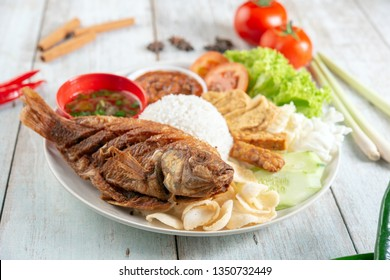 Fried tilapia fish and rice, popular traditional Malay or Indonesian local food.