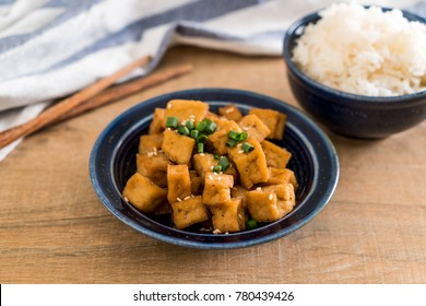 Fried Tofu in a bowl with sesame - healthy and vegan food style