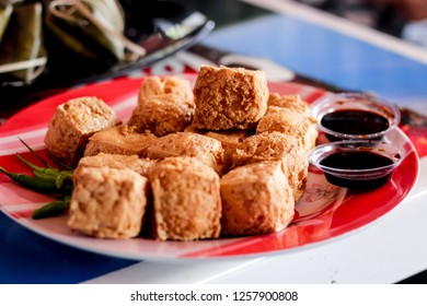 Fried Tofu on a Plate with Soy Sauce and Chilli , Indonesian Traditional Food, Tahu Sumedang Goreng