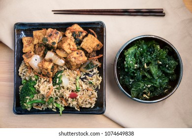 Fried tofu with rice and vegetable stir fry vegan asian meal.