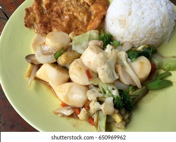 fried tofu with vegetables and Thai Omelette (scrambled eggs) in green dish on wooden table. Thai style Food. Vegetarian Food. vintage tone.
