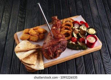 Fried turkey thigh with grilled vegetables and snack for beer