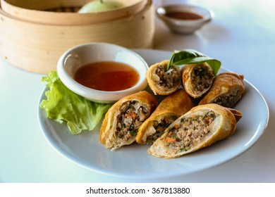 Fried vegetable spring rolls served with sweet chili sauce