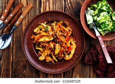 fried vegetables with meat, stew on plate