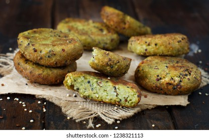 Fried vegetarian broccoli and quinoa burgers on a wooden table top view