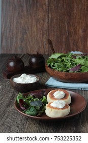 Fried vegetarian cutlets made of potato with sour cream and green salad