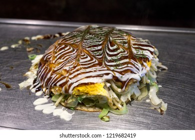 fried yakisoba noodles inside okonomiyaki. Taken in Osaka restaurant.