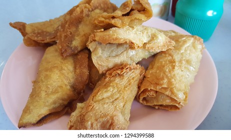 Fried Yong tau foo (also spelled yong tao foo, yong tau fu, yong tau hu) is a Hakka Chinese cuisine consisting primarily of tofu filled with ground meat mixture or fish paste