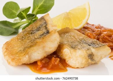 Fried zander with sauce and lemon