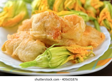 Fried zucchini flowers on the table