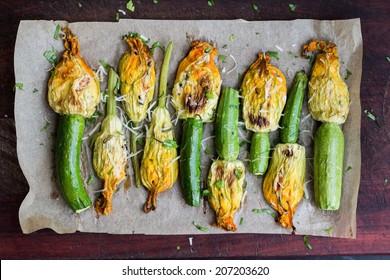 Fried zucchini flowers stuffed with cream cheese, ricotta, tasty Italian dish summer