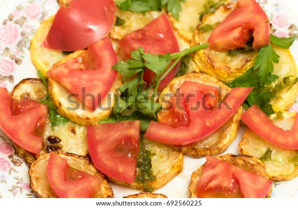 Fried zucchini and tomato food salad