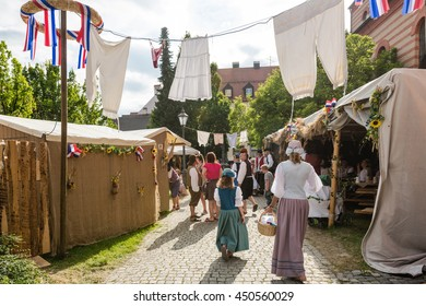 Friedberg, Germany - July 09, 2016: Men and Women dressed in traditional costumes are enjoying authentic food, drinks and other offers of the eighteenth century on the historic festival Friedberger