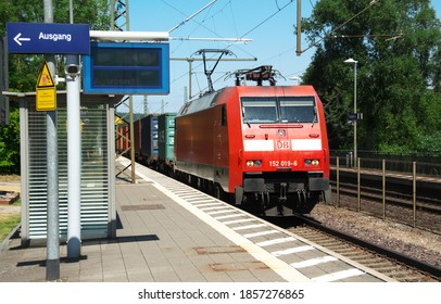 Friedland - Germany - July 18, 2018: 152 019 of Deutsche Bahn with a container train passing through the station.