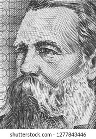 Friedrich Engels on East German 50 mark banknote close up macro. Famous socialist philosopher, communist, social scientist, collaborator of Karl Marx in the foundation of communism. Black and white.