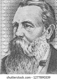 Friedrich Engels on East German banknote closeup macro. Famous socialist philosopher, communist, social scientist, collaborator of Karl Marx in the foundation of communism.
