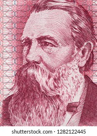 Friedrich Engels on East German banknote closeup macro. Famous socialist philosopher, communist, social scientist, collaborator of Karl Marx in the foundation of communism.