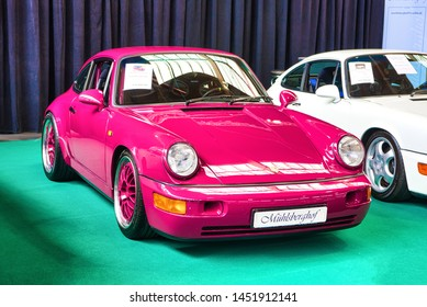 FRIEDRICHSHAFEN - MAY 2019: pink PORSCHE 911 964 RS CARRERA 1992 coupe  at Motorworld Classics Bodensee on May 11, 2019 in Friedrichshafen, Germany.
