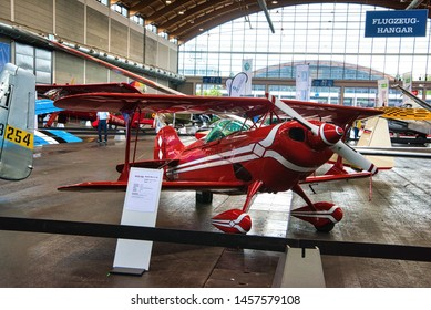FRIEDRICHSHAFEN - MAY 2019: red biplane PITTS S1 11B 2005 at Motorworld Classics Bodensee on May 11, 2019 in Friedrichshafen, Germany.