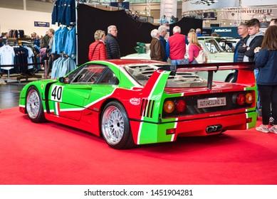 FRIEDRICHSHAFEN - MAY 2019: red green FERRARI F40 1989 at Motorworld Classics Bodensee on May 11, 2019 in Friedrichshafen, Germany.