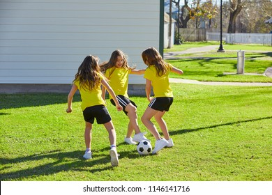 Friend girls teens playing football soccer in a park turf grass