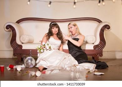 Friend scolding sad bride at a wedding