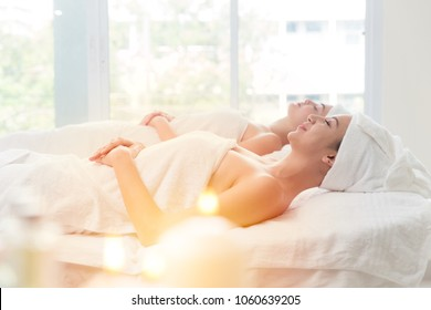 friend two woman at beauty skin care spa and massage relax after work