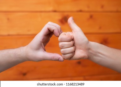 Friend zone symbol. One man showing thumb up, other shape of heart.