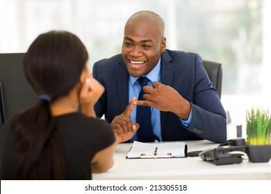 friendly african american businessman meeting with client