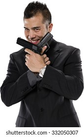 Friendly Asian man with short black hair in business formal outfit holding handgun - Isolated