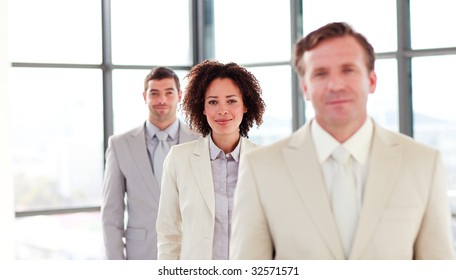 Friendly attractive businesswoman in a line with her colleagues