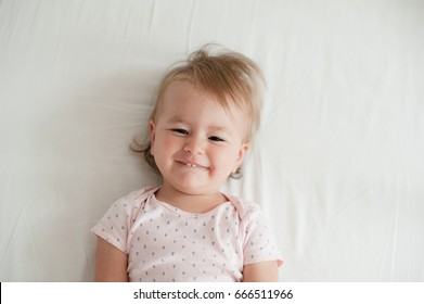 Friendly baby girl smiling