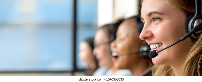 Friendly beautiful caucasian woman telemarketing customer service agent working in call center with multiethnic team