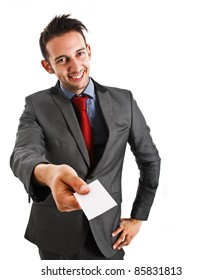 Friendly businessman giving a business card