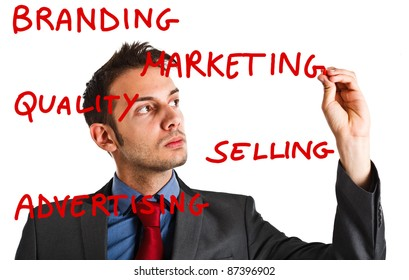 Friendly businessman writing marketing concepts on the screen